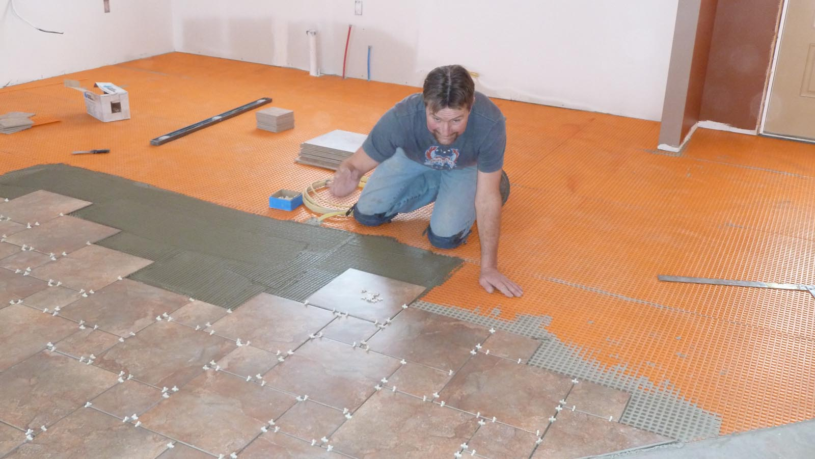 I cant stay away tile and laminate flooring quadomated kitchen tile going down on top dailygadgetfo Choice Image