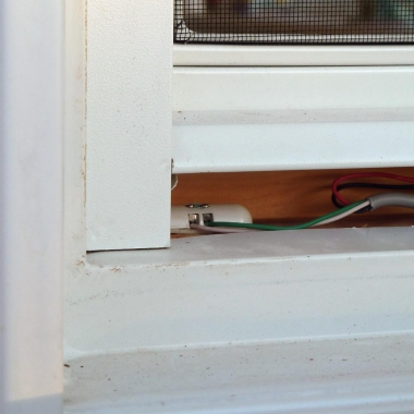 Tane Pill Magnetic Contacts Sensor Installed Underneath Casement Window Trim